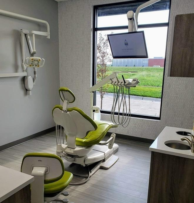 Teeth cleaning room with large window looking out in Urbandale and Johnston Iowa