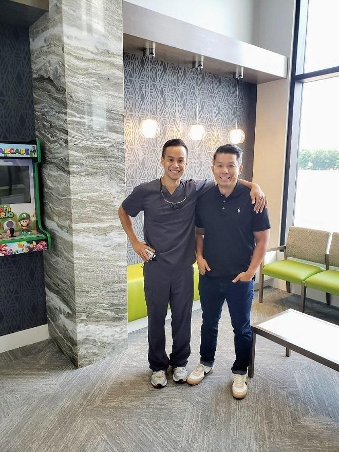 The best patient standing with his dentist Dr. Trung in Urbandale and Johnston Iowa